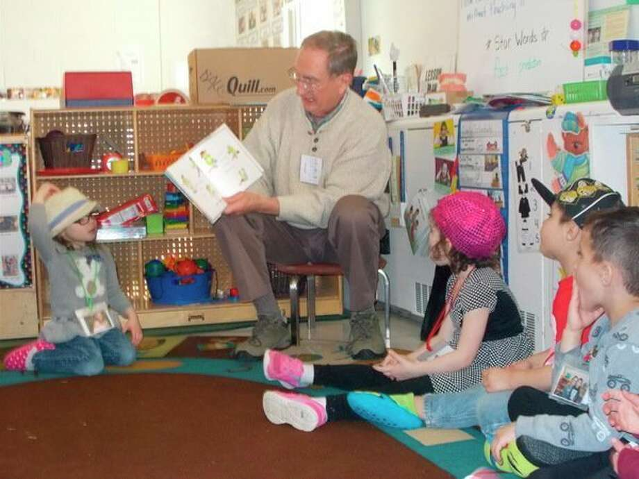 Each month Jim Heffel, a member of the Kiwasee Kiwanis Club, volunteers his time to read in the NEMCSA Midland 4 Head Start/GSRP classroom. The Kiwassee Kiwanis Club now has volunteers reading in eight different preschool classrooms in Midland County. (Photo provided)