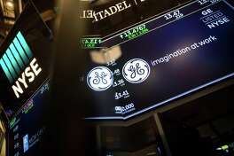 A monitor displays General Electric Co. signage on the floor of the New York Stock Exchange.