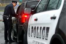 Milford police officer Kyle Magnan stops a motorist for using his cellphone while driving.