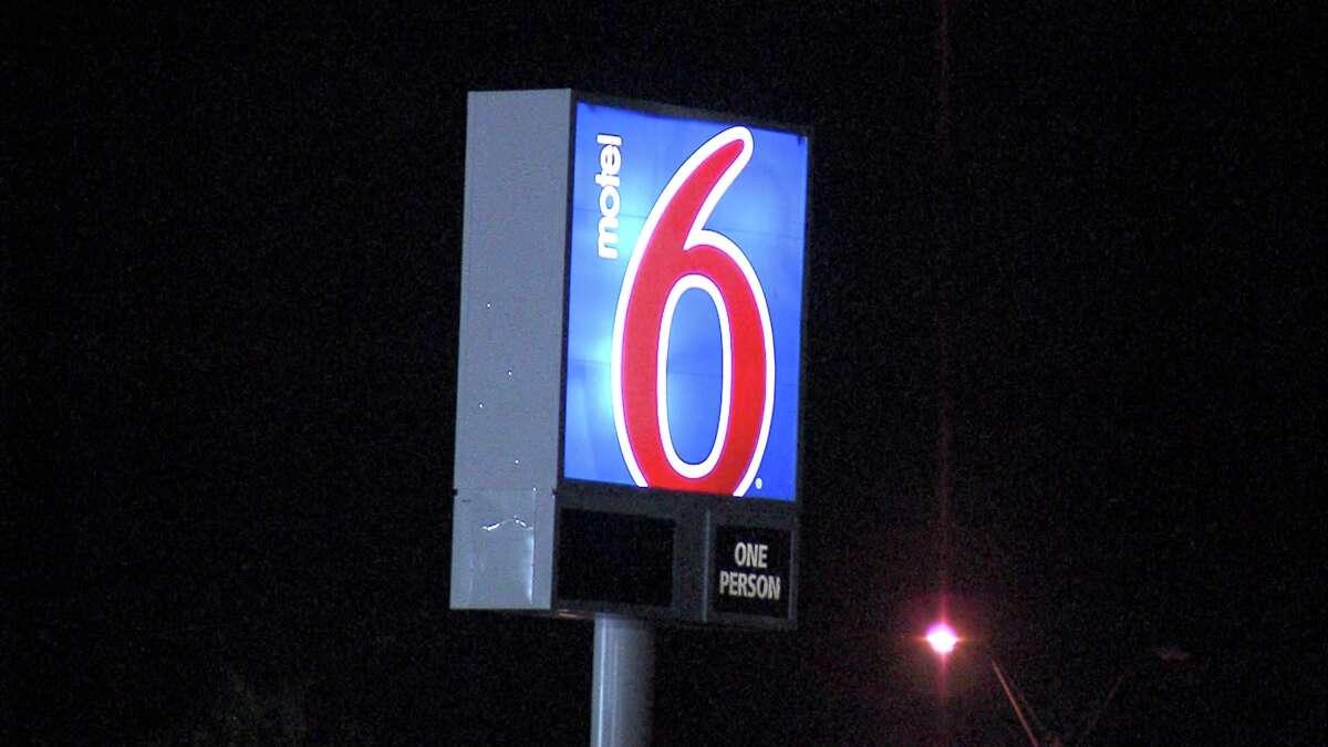 FILE - A Motel 6 sign.