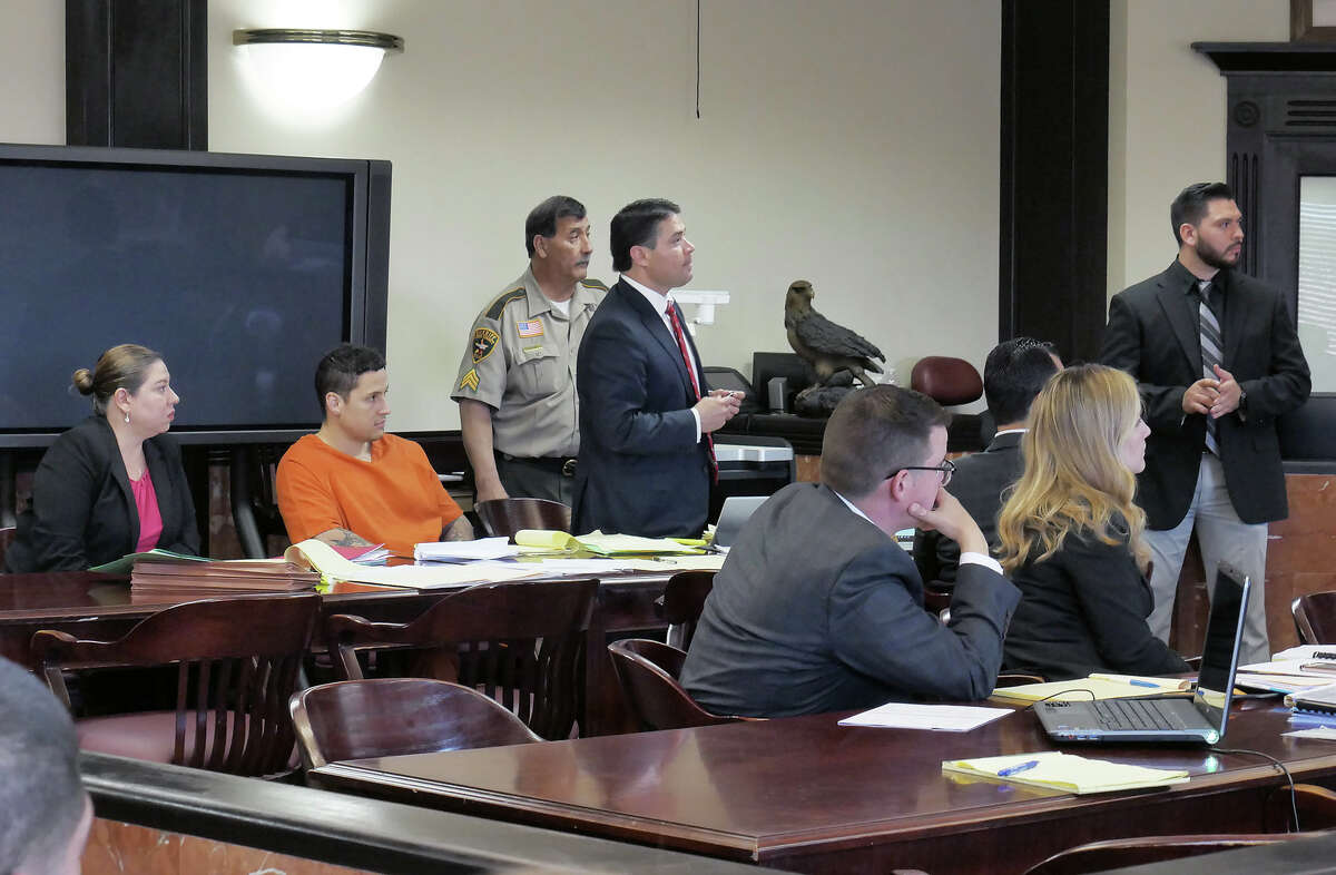 Supervisory Border Patrol Agent Ronald Anthony Burgos-Aviles sits in the 406th District Court during a hearing asking the judge to set a reasonable bond or release him due to lack of probable cause. Burgos-Aviles is charged with two counts of capital murder.
