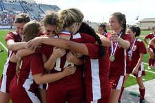 Jasper players hug after Midlothian Heritage defeated them in extra time in the Class 4A girls soccer state final at Birkelbach Field in Georgetown.  Photo taken Thursday 4/19/18 Ryan Pelham/The Enterprise