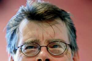 **FILE**In this photo provided by the New Yorker author Stephen King attends a book signing that was part of the New Yorker Festival, on Saturday, Sept. 24, 2005, in New York.  Nineteen lucky bidders who raised $90,000 by paying for the right to name a character -- or a place or thing --in works by noted authors including King and John Grisham. All the money goes to the First Amendment Project, an Oakland-based nonprofit organization devoted to protecting freedom of information, expression and petition.  The online auction began Sept.1 and ended Sunday, Sept.25.  (AP Photo/New York Festiival,Albert Ferreira  )