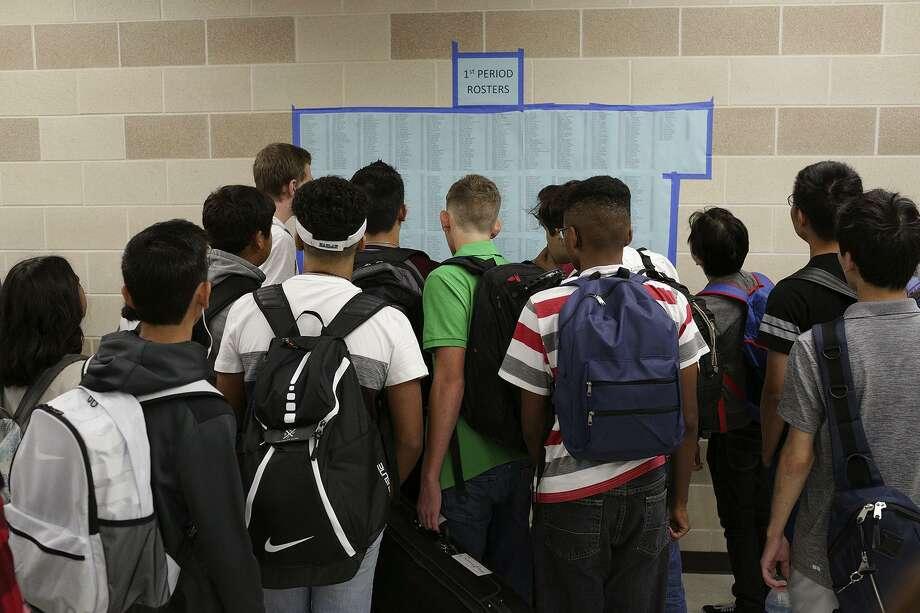 Students look for their classrooms on the first day of school at John M. Harlan High School on August 28, 2017. According to the Texas Education Agency, state funding has increased to over 45 percent in the last decade. Photo: Lisa Krantz /SAN ANTONIO EXPRESS-NEWS / SAN ANTONIO EXPRESS-NEWS