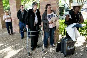 Elaine Pate, center, Mary Trevino and Lucy Orlando wait in line to board shuttle busses at Second Baptist Church to pay their last respects to former first lady Barbara Bush on Friday, April 20, 2018, in Houston.