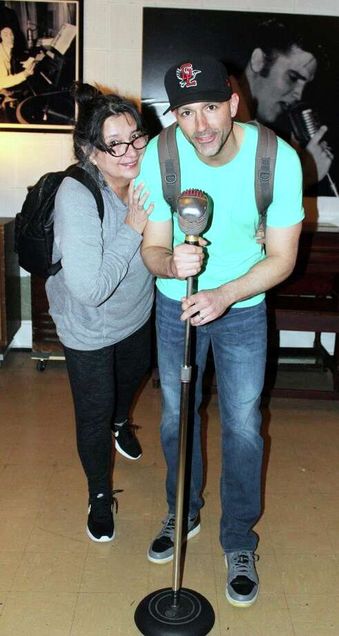 Seth Stapleton and his mom pose with a mic once used by Elivs Presley. (Seth Stapleton/Huron Daily Tribune)