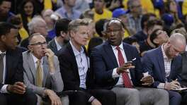 Mike Brown, right, likes his spot on Golden State's bench.