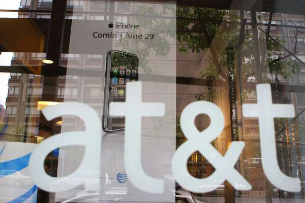 A 2007 file photo of an AT&T store front logo in New York. MUST CREDIT: Bloomberg photo by Andrew Harrer.