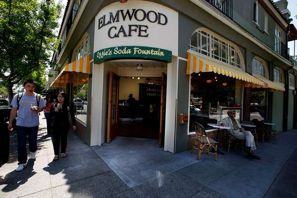 People passing by Elmwood Cafe during a sunny mid afternoon in Berkeley, Calif., on Friday, April 23, 2010.