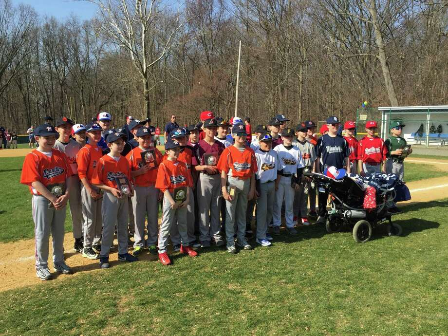 The 12-year old players from the Fairfield National Little League Majors teams were honored at Opening Day ceremonies at Tunxis Hill Park on April 14. Photo: Chris Elsberry / Hearst Connecticut Media