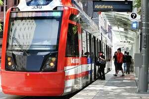 A Metropolitan Transit Authority light rail train sits at the Theater District platform April 10 in downtown Houston.
