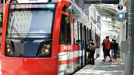 A Metropolitan Transit Authority train sits the Theater District platform on April 10 in downtown Houston.