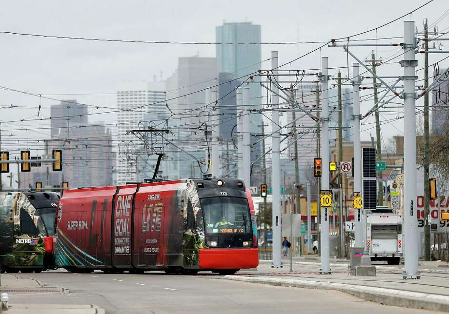 """A Metropolitan Transit Authority train cuts across Harrisburg beneath the catenary electrical system that powers the trains. Those electrical lines are suffering from what a Metro official called """"wire fatigue"""" leading to a shutdown of much of the rail system on Wednesday. Photo: Karen Warren, Staff Photographer / Houston Chronicle / 2016 Houston Chronicle"""
