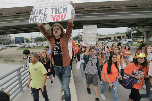 Houston high school students walk out of class during the Houston Youth Walkout, a march to coincide with the anniversary of the 1999 Columbine High School shooting, on Friday, April 20, 2018, in Houston.