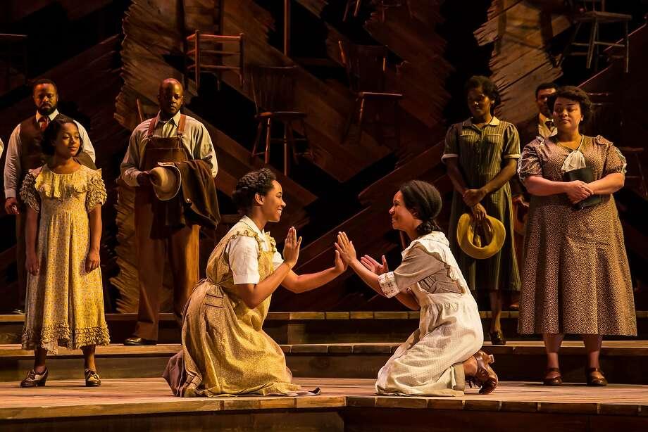 "Adrianna Hicks (Celie) and N'Jameh Camara (Nettie) in ""The Color Purple."" Photo: Matthew Murphy"