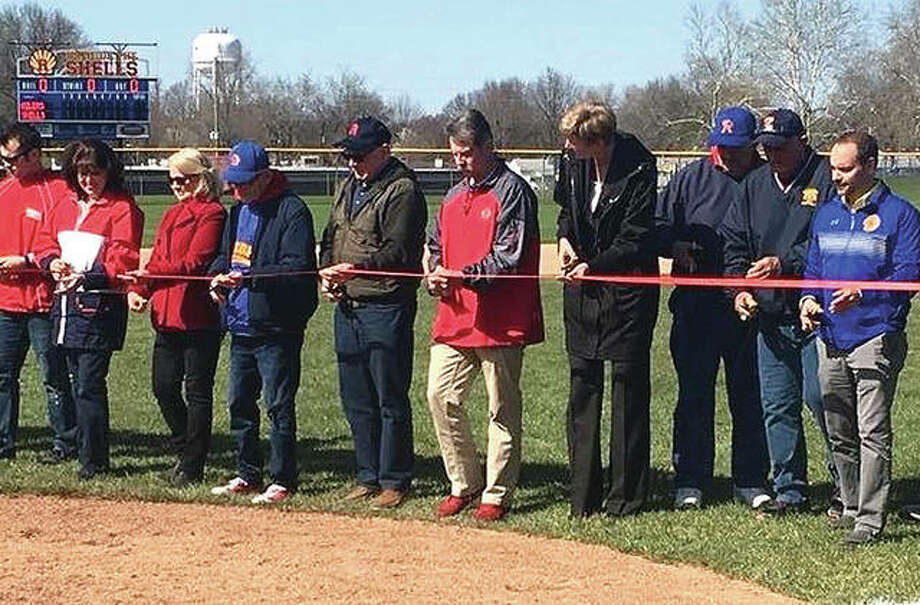 A ribbon cutting to officially open the refurbished Roxana High School baseball field took place prior to the Shells' home game against East Alton-Wood River. The ceremony had been delayed twice by weather. Photo:       Submitted Photo