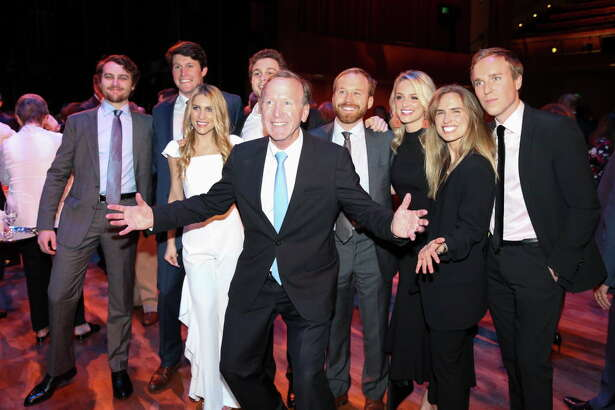 Neil Bush jumps in to take a photograph with his children, step-children — and their significant others — at the Barbara Bush Literacy Foundation's annual Celebration of Reading at Hobby Center on Thursday, April 19, 2018, in downtown Houston. From left: Pace Andrews, Robbie Derrick, Lizzie Andrews, Alexander Andrews, Pierce and Sarahbeth Bush, Ashley Bush and Julian LeFevre.
