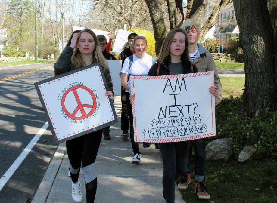 Darien High School students walk down Noroton Avenue toward the Metro North Train Station on April 20 in Darien. Photo: Justin Papp / Hearst Connecticut Media / Darien News