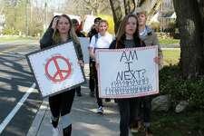 Darien High School students walk down Noroton Avenue toward the Metro North Train Station on April 20 in Darien.