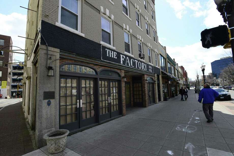 An exterior of The Factory at 261 Main St., in downtown Stamford, Conn. The soon-to-open bar and grill is one of several restaurants located around Columbus Park. Photo: Matthew Brown / Hearst Connecticut Media / Stamford Advocate