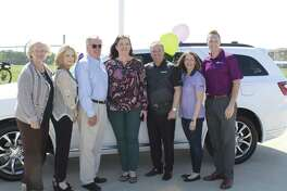 ALLIES ALL: Melinda McMahan of Houston was a winner of an augmented reality game during this year's Super Bowl and didn't have to pay a cent for a spiffy new Dodge Durango. From left to right: Nini Hellmer and Denise Douglas of Ally Financial; Bruce Glascock, Southfork Chrysler Dodge Jeep Ram; McMahan; Christopher Godwin, Southfork Chrysler Dodge Jeep Ram; Cristi Vazquez and Dane Kaulfuss of Ally Financial.