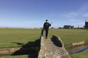 Don Burns stands on the Swilken Bridge on The Old Course at the St. Andrews Golf Club in Scotland.