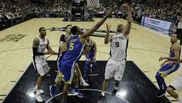 Golden State Warriors' Kevon Looney (5) defends against a shot by San Antonio Spurs' Tony Parker (9) in the second half of Game 3 of a first-round NBA basketball playoff series in San Antonio, Thursday, April 19, 2018. Golden State won 110-97. (AP Photo/Eric Gay)