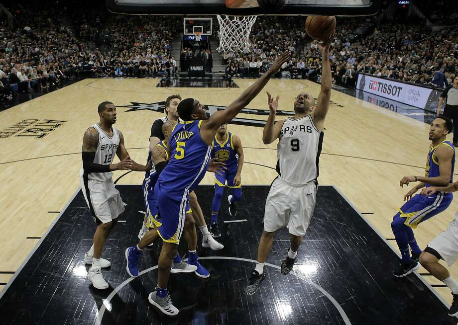 Golden State Warriors' Kevon Looney (5) defends against a shot by San Antonio Spurs' Tony Parker (9) in the second half of Game 3 of a first-round NBA basketball playoff series in San Antonio, Thursday, April 19, 2018. Golden State won 110-97. (AP Photo/Eric Gay) Photo: Eric Gay / Associated Press