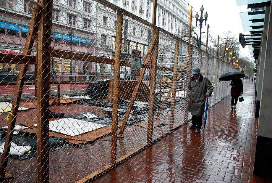 An entrance to the Powell Street BART Station is closed for construction of a covered canopy above it near Fourth and Market streets in March. Photo: Paul Chinn / The Chronicle