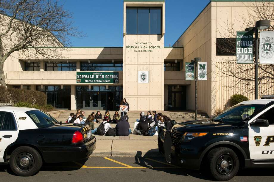 Norwalk High School students participate in a school walkout in Norwalk, Conn. on Friday, April 20, 2018. The National School Walkout took place nationwide to commemorate the 19th anniversary of the Columbine shooting, as well as to maintain awareness on stopping school violence. Photo: Chris Palermo / For Hearst Connecticut Media / Norwalk Hour Freelance