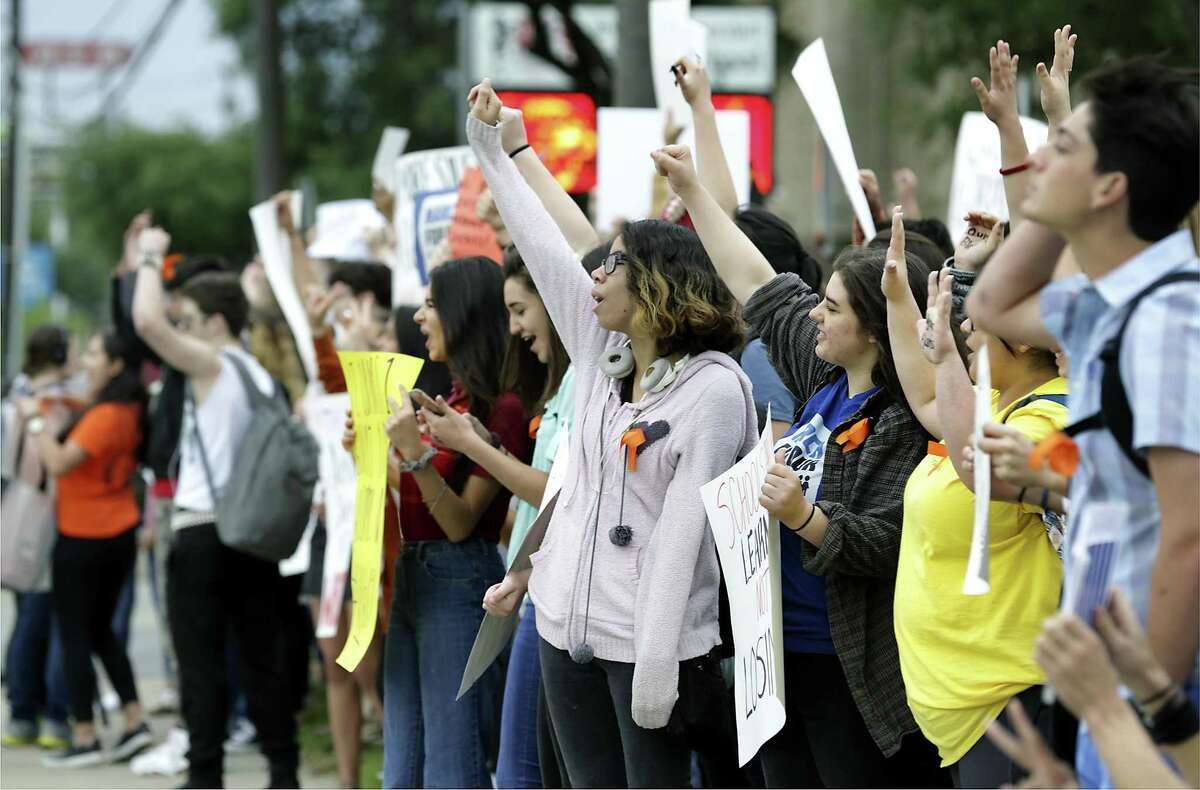 Students at Churchill High School walked out of class and gathered on the sidewalk along Blanco Rd on Friday, April 20, 2018 to participate in the National School Walkout to protest gun violence in the wake of the Parkland shootings.