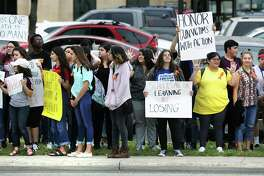 Students at Churchill High School walked out of class to gather on the sidewalk in front of the school along Blanco Rd on Friday, April 20, 2018 to participate in the National School Walkout to protest gun violence in the wake of the Parkland shootings.