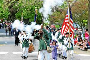 The Milford Volunteers march in the 2014 Milford Memorial Day Parade. This year's parade, preceded by a wreath-laying ceremony, will take place on Sunday, May 27. File photo.