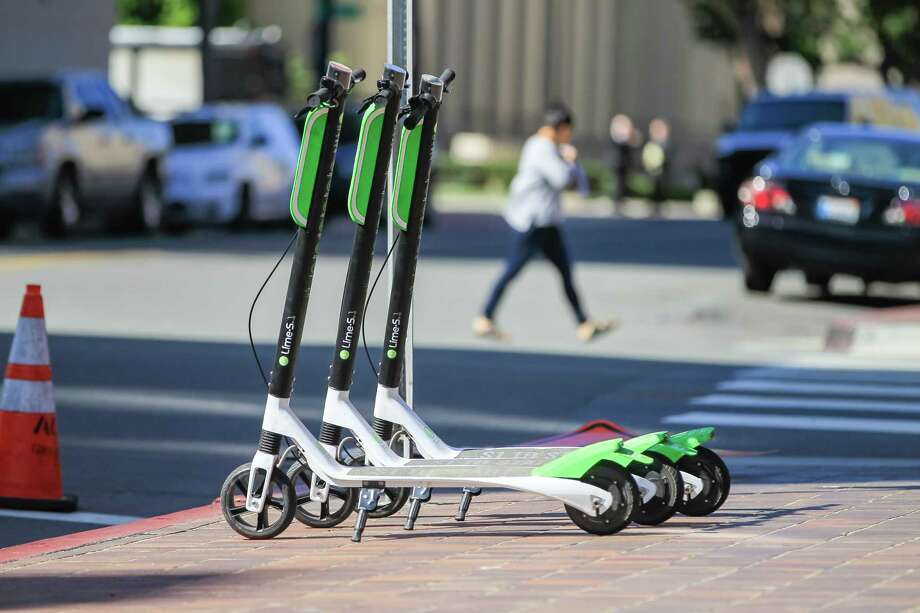 Scooters are also entering cities as additional mobility options. In this photo: LimeBike models in downtown San Diego. Photo: Eduardo Contreras, TNS / San Diego Union-Tribune