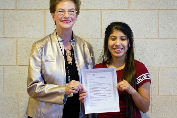 Lone Star College-Kingwood President Katherine Persson (left) presents a $250 scholarship to student Valeria Sanchez on April 16 as part of the Project Connections program. The project is hosted by Lone Star College and the Rotary Club of East Montgomery County.