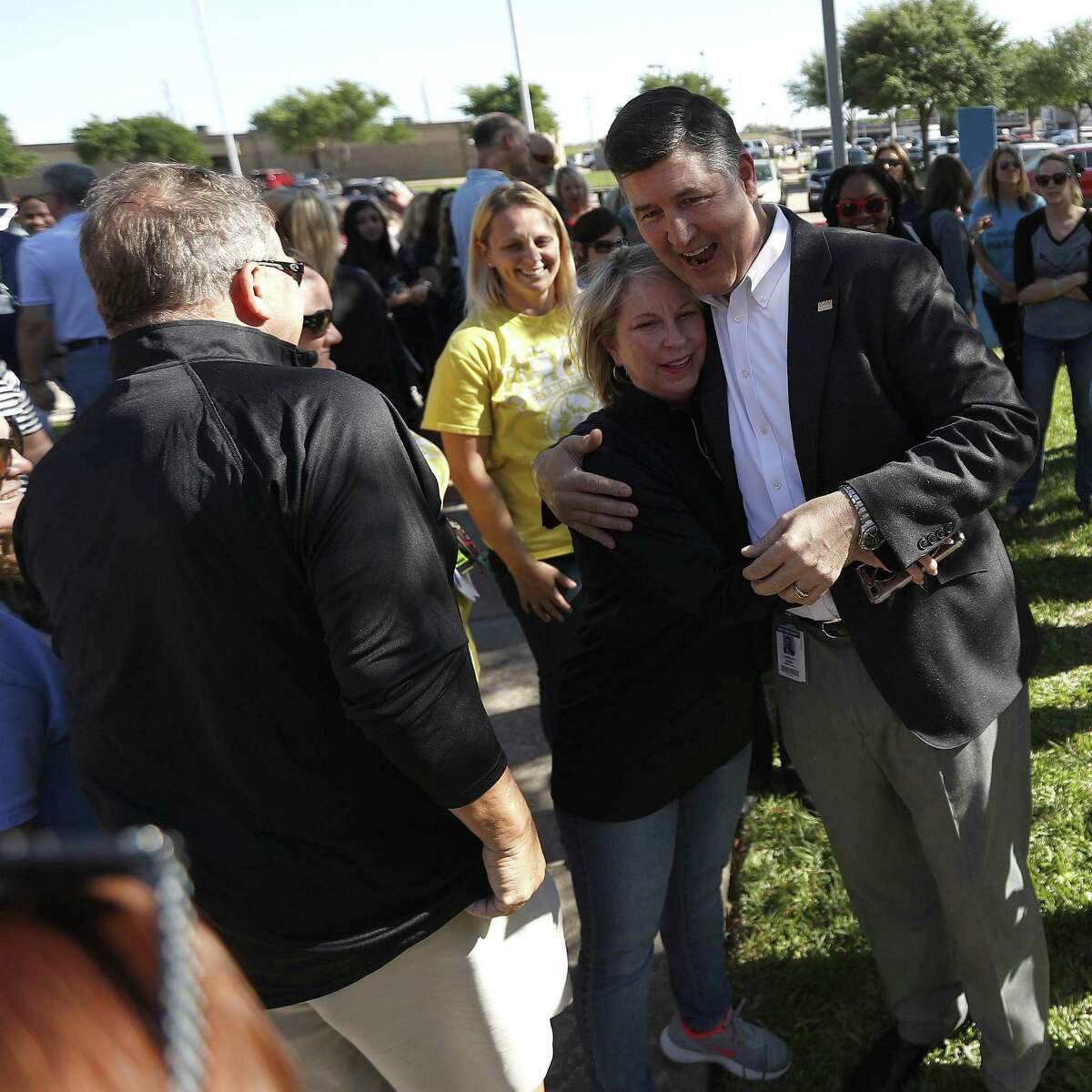 Katy superintendent, Dr. Lance Hindt greets people after he was surrounded by members of the Katy community who have organized a support circle and rally before the Katy ISD Board of Trustees Work Study Meeting, Monday, April 16, 2018, in Katy. Based on the book ?