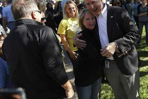 """Katy superintendent, Dr. Lance Hindt greets people after he was surrounded by members of the Katy community who have organized a support circle and rally before the Katy ISD Board of Trustees Work Study Meeting,  Monday, April 16, 2018, in Katy.  Based on the book """"The Circle Maker"""" by Pastor Mark Batterson, this event seeks to uplift Dr. Hindt through the power of positivity. Participants will stand shoulder to shoulder to form a circle around Dr. Hindt to show their support of his leadership. ( Karen Warren / Houston Chronicle )"""