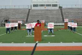 Texas City High School student Political Activism Club President Jaeden Johnson prepares to make a statement as fellow students hold signs with names of the victims from the Marjory Stoneman Douglas High School shooting in Parkland, FL during a walk out for school safety Friday, Apr. 20 at Texas City High School.