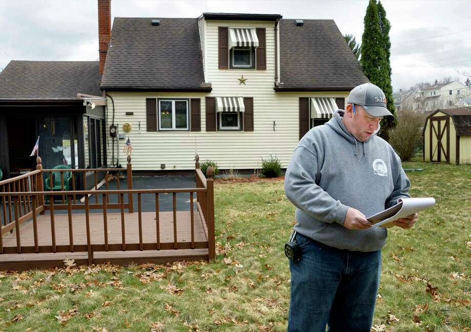 Home buyer Shawn Gilbert reviews his check list in the backyard of 19 Jay St. Tuesday April 17, 2018 in Waterford, NY.  (John Carl D'Annibale/Times Union) Photo: John Carl D'Annibale / 40043527A