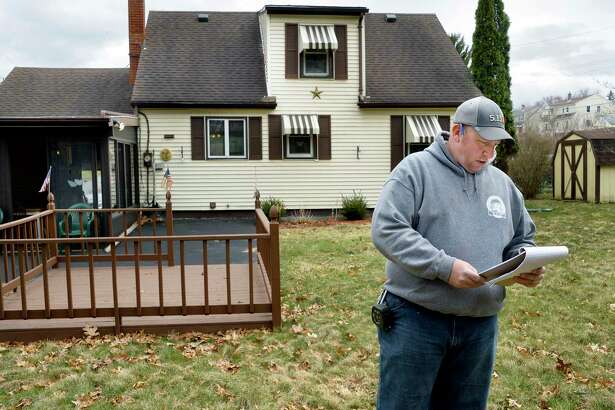 Home buyer Shawn Gilbert reviews his check list in the backyard of 19 Jay St. Tuesday April 17, 2018 in Waterford, NY.  (John Carl D'Annibale/Times Union)