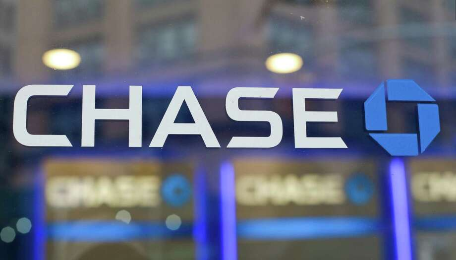 This Sept. 13, 2014, photo, shows the Chase bank logo in New York. The nations six big Wall Street banks posted record or near record profits in the first quarter, thanks largely to the recently enacted Trump tax law. Combined, the six banks saved at least $3.59 billion in taxes last quarter, according to an Associated Press estimate, Friday, April 20, 2018, using the banks tax rates going back to 2015. Photo: Frank Franklin II /Associated Press / AP2014