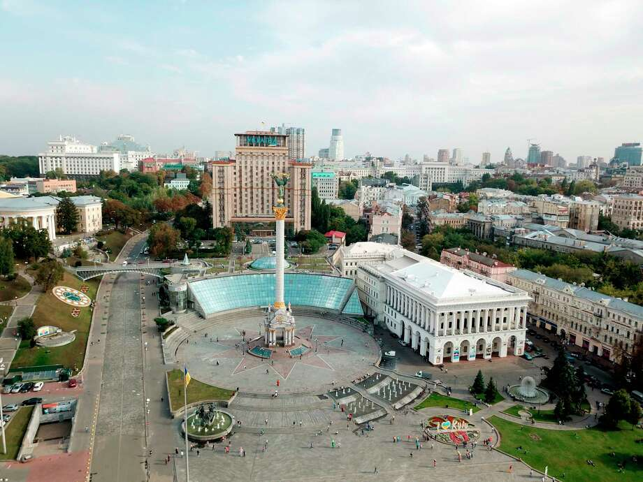 This Sept. 21, 2017 photo taken in Kiev, Ukraine, shows Maidan, the site of deadly protests in 2014 that ushered in the country's pro-European revolution. The square is now a bustling tourist hotspot and home to the towering Independence Monument. (AP Photo/Nicole Evatt) Photo: Nicole Evatt / Copyright 2018 The Associated Press. All rights reserved.