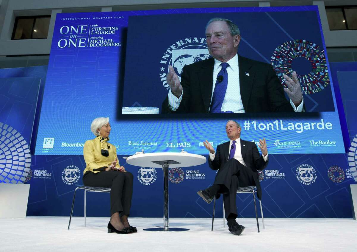 Former New York City Mayor and UN Special Envoy for Climate Action Michael Bloomberg accompanied by International Monetary Fund (IMF) Managing Director Christine Lagarde speaks at World Bank/IMF Spring Meetings, in Washington, Thursday, April 19, 2018. ( AP Photo/Jose Luis Magana)