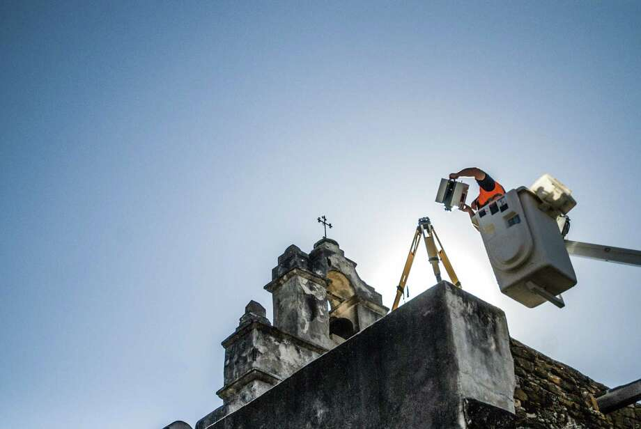 A CyArk field technician from Critigen positions a laser scanner atop Mission San Juan to capture an accurate 3-D map of the site. The missions of San Antonio Missions National Historical Park were scanned in 2010, with the data now available to the public via the Open Heritage project. Photo: Courtesy CyArk