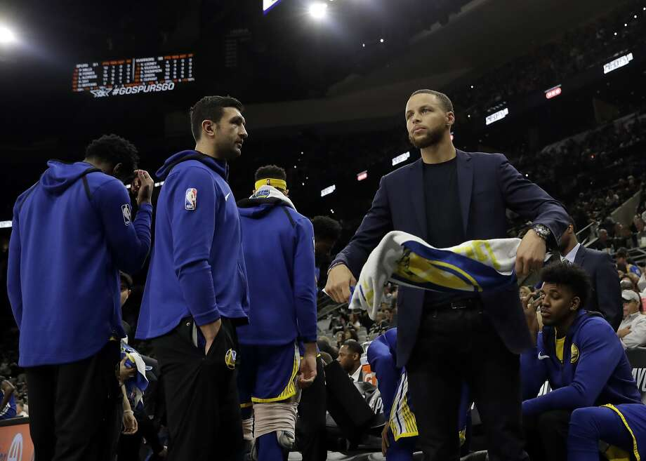 Golden State Warriors' Zaza Pachulia, left, watches as Stephen Curry, right, spins a towel in his hands in the second half of Game 3 of a first-round NBA basketball playoff series against the San Antonio Spurs in San Antonio, Thursday, April 19, 2018. Golden State won 110-97. (AP Photo/Eric Gay) Photo: Eric Gay / Associated Press