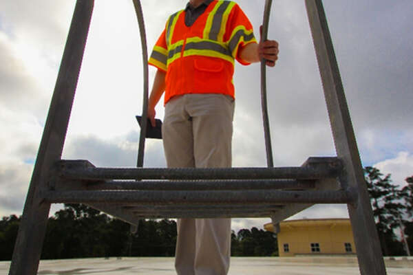 An associate with LAN conducts an assessment of a New Caney ISD facility.