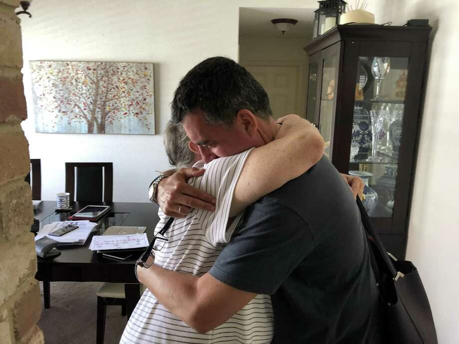 John Wayne Nelson hugs his newly discovered cousin Janice Brady French. Born and raised in France, Nelson used DNA analysis to track down his family in America. Photo: Richard A. Marini /San Antonio Express-News