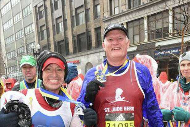 Jorge Garcia, left, and Bill Burke after completing the marathon.