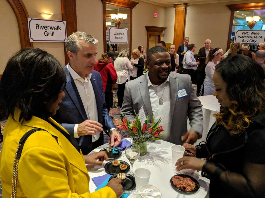 More than 1,100 people attended the annual Chefs for Shelterhouse fundraiser Thursday at The Great Hall, where chefs cooked up mouth-watering samples. The event is Shelterhouse's largest fundraiser and proceeds support operations. Photo: Tereasa Nims / For The Daily News