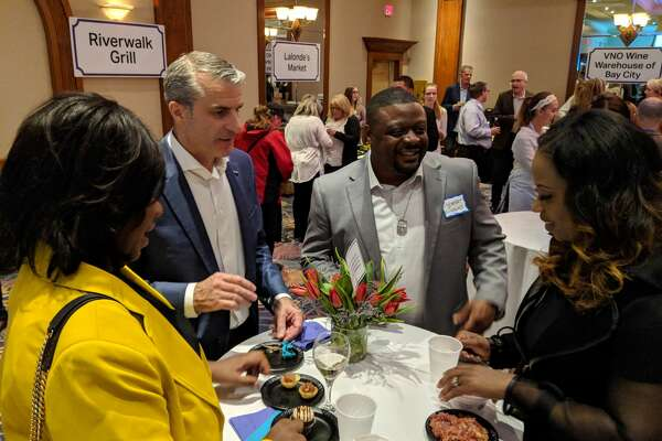 More than 1,100 people attended the annual Chefs for Shelterhouse fundraiser Thursday at The Great Hall, where chefs cooked up mouth-watering samples. The event is Shelterhouse's largest fundraiser and proceeds support operations.
